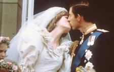 FILE: Charles, Prince of Wales, kisses his bride, Lady Diana, on the balcony of Buckingham Palace when they appeared before a huge crowd, on 29 July 1981, after their wedding in St Paul's Cathedral. Picture: AFP.