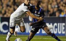 Tottenham Hotspur's Alan Hutton (L) vies with Inter Milan's Samuel EtoÕo (R) during their UEFA Champions League match. Picture: AFP