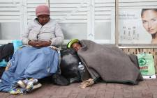 Margriet Pienaar sits under a blanket on a cold winters day in Cape Town. Pienaar has been living on the street for 15 years. Picture: Bertram Malgas/EWN