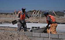 FILE: Builders at a housing project in Cape Town. Picture: Aletta Gardner/EWN.
