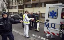Twelve people, including two police officers, were killed in the shooting at Charlie Hebdo's office in Paris on 7 January 2015. Picture: AFP.