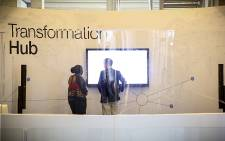 FILE: A WEF official talks to a delegate at last year's World Economic Forum in Cape Town. Picture: Thomas Holder/EWN