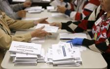 Election workers open mail-in ballots at the Boulder County Clerk and Recorder's Office on November 6, 2012 in Boulder, Colorado.  Picture: AFP