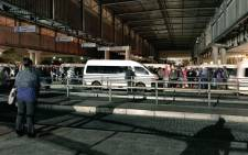 FILE: Commuters at a bus terminal in Mitchells Plain, Cape Town queue for taxis due to a bus strike on 18 April 2018. Picture: Cindy Archillies/EWN