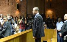 FILE: Oscar Pistorius stands in the dock as he waits to hear the outcome of his bail application. Picture: Lesego Ngobeni/EWN.