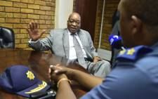 President Jacob Zuma chats to police officers at the Nyanga Police Station in cape Town. Picture: @PresidencyZA/Twitter