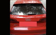 Crime Intelligence recovered a red Audi on Saturday with a number of weapons and ammunition in Fordsburg. Picture: @MichaelSun168/Twitter.
