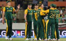 South Africa's players celebrate a wicket during the 2015 Cricket World Cup Pool B match between Ireland and South Africa in Canberra on 3 March, 2015. Picture: AFP.