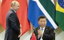 FILE: China's President Xi Jinping (R) and Russia's President Vladimir Putin attend a meeting with members of the Business Council and management of the New Development Bank during the BRICS Summit in Brasilia, 14 November 2019. Picture: AFP
