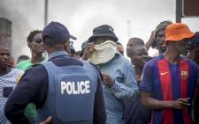During a lull, protesters prepare for another bout of clashes with police in Krugersdorp on 22 January 2018. Picture: Thomas Holder/EWN