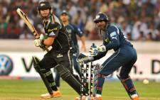 Batsman Jesse Ryder (L) plays a shot during an IPL Twenty20. Picture: AFP