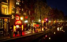 FILE: The red-light district, known as De Wallen, in Amsterdam. De Wallen is the largest red-light district situated in the centre of Amsterdam and a major tourist attraction. Picture: AFP.