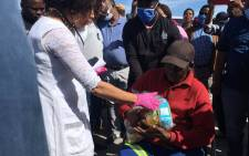 Human Settlements Minister Lindiwe Sisulu handed out sponsored food parcels to some residents eMpolweni informal settlement in the Western Cape. Picture: Jarita Kassen/EWN