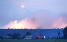 This photo taken on 27 September 2017 near Kalynivka shows explosions at a military munitions depot. Ukranian authorities evacuated nearly 30,000. Picture: AFP