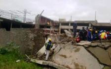 Emergency and construction workers among the rubble at the site of a collapsed mall in Tongaat, KwaZulu-Natal, on 19 November 2013. Picture: @Mariolungelo/Twitter.