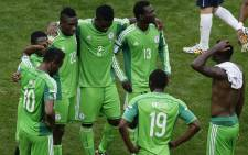 Nigeria players react after the Fifa World Cup 2014 round of 16 match between France and Nigeria in Brazil on 30 June 2014 which France won 2-0. Picture: EPA.