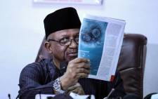 Nigeria's Minister for Health Osagie Ehanire displays an image of the novel coronavirus COVID-19 as he address the media regarding the first case of the virus confirmed in Nigeria during a press briefing in Abuja on 28 February 2020. Picture: AFP