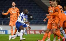 FC Porto's Malian forward Moussa Marega (C) celebrates his goal during the UEFA Champions League round of 16 first leg football match between Porto and Juventus at the Dragao stadium in Porto on 17 February 2021. Picture: MIGUEL RIOPA/AFP