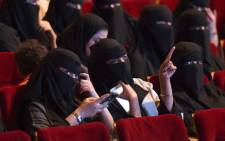 This file photo taken on 20 October 2017 shows Saudi women attending the 'Short Film Competition 2' festival at King Fahad Culture Center in Riyadh. Picture: AFP