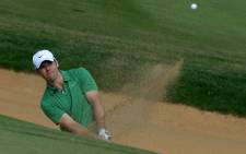 FILE: Paul Casey of England plays from the bunker at the 7th hole before finishing equal fifth on the third day of the BMW Shanghai Masters golf tournament on October 26, 2013. Picture: AFP.