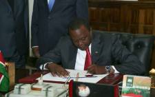 Kenyan President Uhuru Kenyatta signs an anti-doping amendment bill. Picture: @UKenyatta via Twitter.