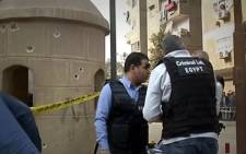 This screengrab shows officials on scene where at least 11 people were killed in attacks on a Coptic Orthodox church and a Christian-owned shop near Cairo on Friday, 29 December 2017. Picture: Reuters.com