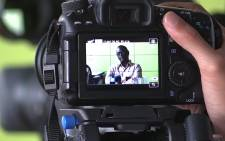 Zwelinzima Vavi, through a camera viewfinder, he says he won't be appealing his Cosatu dismissal. Picture: Vumani Mkhize/EWN.