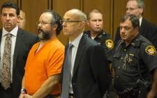 Ariel Castro (2L) listens as Judge Michael Russo reads his sentence on August 1, 2013 in Cleveland, Ohio. Castro was sentenced to life without parole plus one thousand years for abducting three women between 2002 and 2004 when they were between 14 and 21 years old. Picture: AFP.