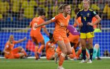 Netherlands' midfielder Jackie Groenen (C) celebrates after winning the France 2019 Women's World Cup semifinal football match between the Netherlands and Sweden, on 3 July 2019, at the Lyon Stadium in Decines-Charpieu, central-eastern France. Picture: AFP