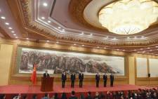 Chinese President, and General Secretary of the Communist Party Xi Jinping (L) gives a speech during the introduction of the Communist Party of China's Politburo Standing Committee, in Beijing's Great Hall of the People on 25 October 2017. Picture: AFP.