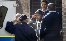 Mziwamdoda Qwabe leaves the Wynberg Magistrates Court in 2011, following his arrest for the murder of Anni Dewani