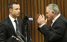 FILE: Oscar Pistorius and his lawyer Barry Roux at the High Court in Pretoria on 5 March 2014. Picture: Pool.