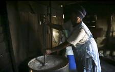 FILE: A woman makes umqombothi. Picture: EWN