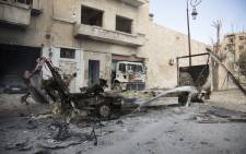 The wreckage of vehicles are seen outside a civil defence centre in the Aleppo neighbourhood of Bab al-Nayrab following recent government air strikes. Picture: AFP