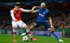 Arsenal's Spanish defender Hector Bellerin (L) vies with Monaco's French defender Layvin Kurzawa (R) during the UEFA Champions League round of 16 first leg football match between Arsenal and Monaco at the Emirates Stadium in London on February 25, 2015. Picture: AFP