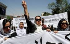 Women in Afghanistan protest for women's rights following the execution of a woman charged with adultery. Picture: AFP