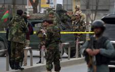 FILE: Afghan security personnel gather near the site of an explosion in Kabul on 8 March, 2017. An explosion and gunfire rattled Kabul's diplomatic district, as insurgents attacked Afghanistan's largest military hospital, officials said. Picture: AFP