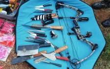 Some of the weapons confiscated by the Hawks' North West Serious Organised Crime Unit that are believed to have been used to illegally slaughter lions and tigers in the North West. Picture: @SAPoliceService/Twitter