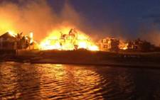 Dozens of houses were gutted when a fire spread through St Francis Bay on 11 November 2012. Picture: Supplied