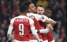 Arsenal's Pierre-Emerick Aubameyang and team members embrace after Aubameyang scored twice, leading to the team's victory over Rennes. Picture: @Arsenal/Twitter