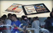 Customers flock to an Apple store where the latest version of the Apple iPad went on sale in Apple stores in Shanghai on July 20, 2012. Apple began selling the latest version of its market-leading iPad in China, on the heels of Apple paying 60 million USD to end a dispute over the iPad name in China, giving the US tech giant more certainty in selling its tablet computer in the huge market. Picture: AFP.