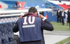 FILE: Neymar shows off his new PSG shirt. Picture: Twitter/@PSG_inside.