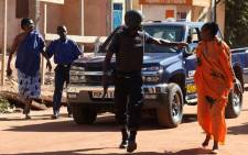 FILE: Malian security forces evacuate two women from an area surrounding the Radisson Blu hotel in Bamako on 20 November, 2015. Picture: AFP.