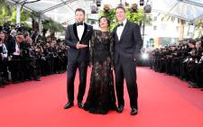 FILE: Australian actor Joel Edgerton, Irish-Ethiopian actress Ruth Negga and US director Jeff Nichols pose as they arrive on 16 May, 2016 for the screening of the film 'Loving' at the 69th Cannes Film Festival in Cannes, southern France. Picture: AFP.