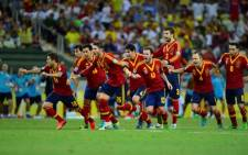 The Spanish soccer team celebrates after defeating Italy in their FIFA Confederations Cup semifinal match in Brazil on 27 June 2013. Picture: AFP