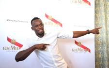 Jamaican sprinter Usain Bolt  does his signature move at a GH Mumm conference in Cape Town. The world record holder is in Cape Town for the Sun Met. Picture: Bertram Malgas