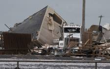 A semi truck sits among the rubble after a tornado struck the American Budget Value Inn 26 May 2019 in El Reno, Oklahoma. Picture: AFP