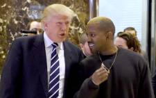 Singer Kanye West and President-elect Donald Trump arrive to speak with the press after their meetings at Trump Tower in 2016 in New York. Picture: AFP.