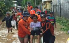 A CNN video screengrab of people affected by Tropical Storm Tembin in the Philippines.