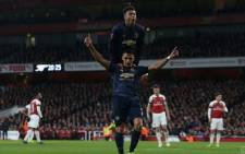 Chilean forward Alex Sanchez and Jesse Lingard celebrate a goal during Manchester United's heavyweight FA Cup fourth-round clash against Arsenal. Picture: @ManUtd/Twitter.